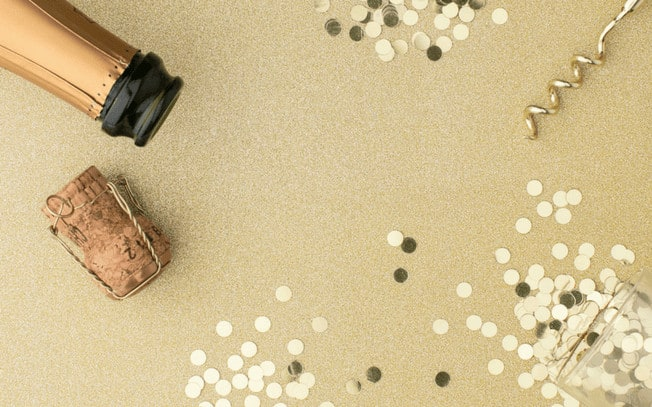 Picture of champagne bottle and gold confetti