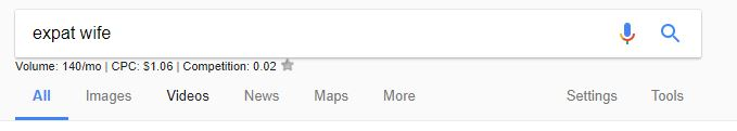 """Screenshot of the word """"expat wife"""" in Google's search bar"""