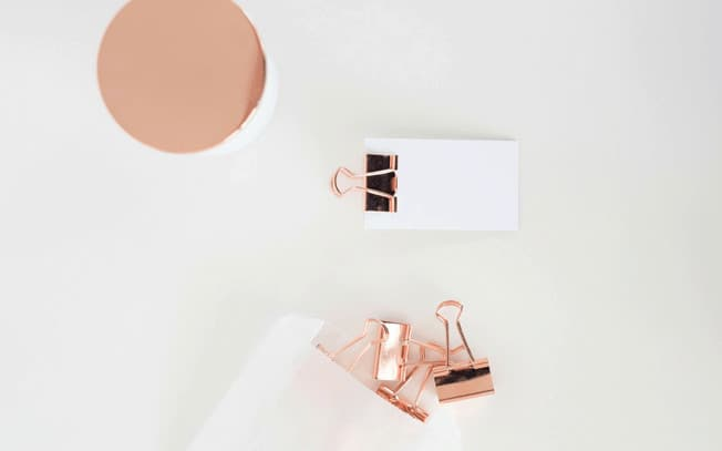 Rose gold paper clips and paper
