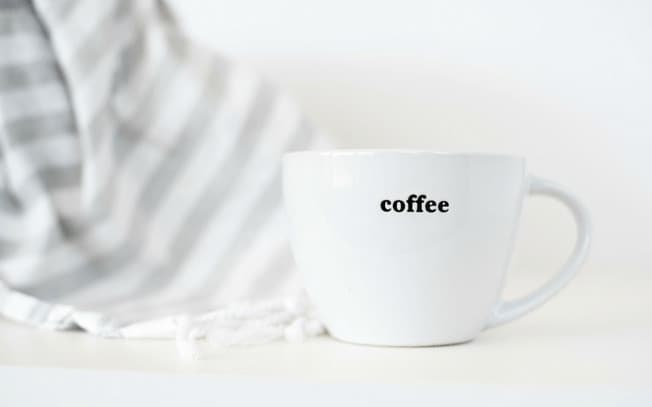 """a cup that says """"coffee"""""""