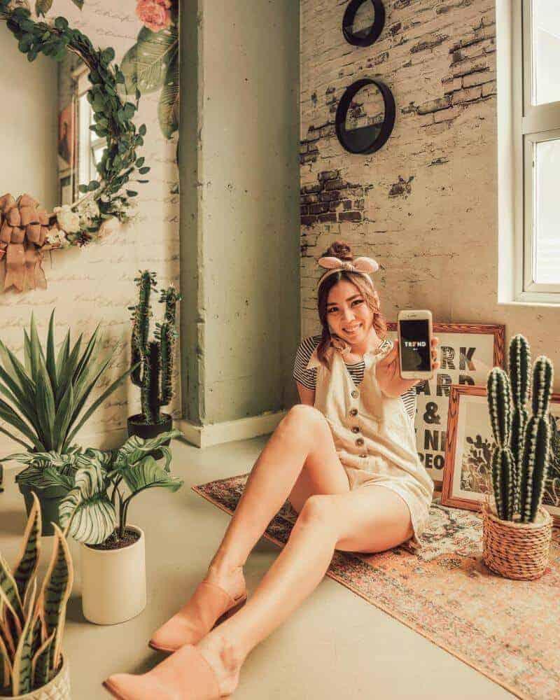 Girl sitting on floor near plants