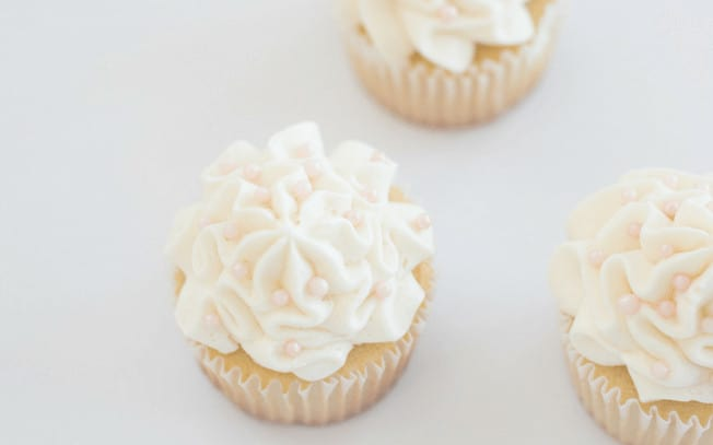 Two cupcakes with white icing
