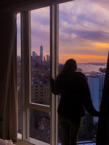 Girl standing in front of skyline