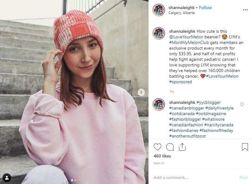 Instagram post of a girl in a pink sweater wearing a tye dye toque