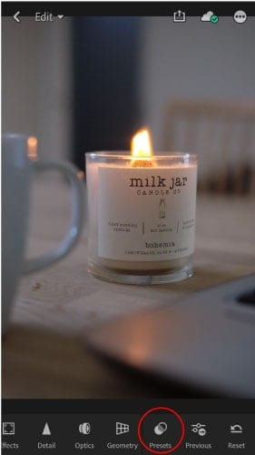 A picture of a candle being editing in lightroom mobile app