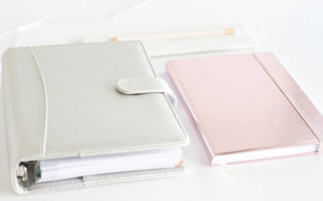 Grey and pink notebook side by side