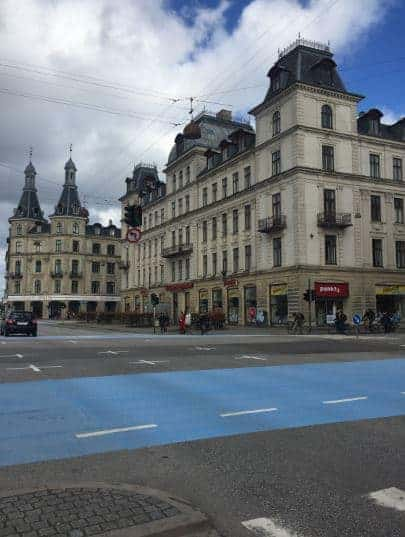 European building with a blue crosswalk