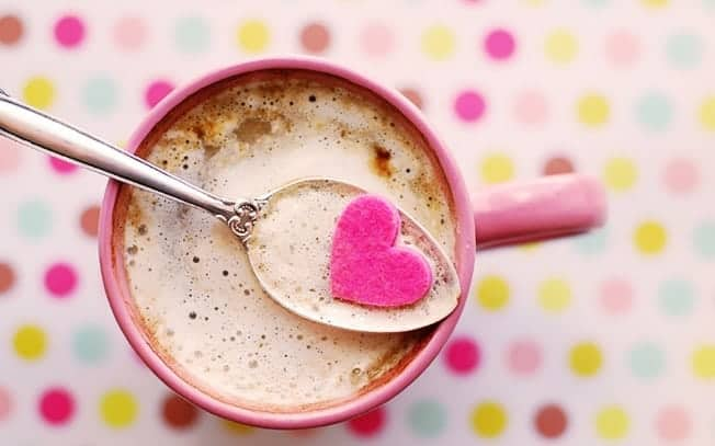 Hot chocolate with a spoon and a heart on the spoon