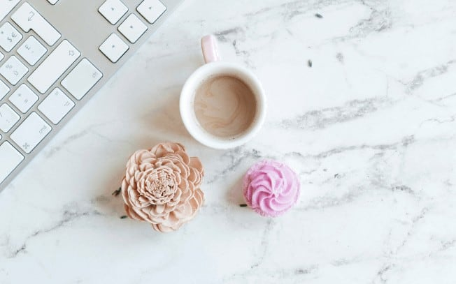 coffee and cupcakes on a marble desk