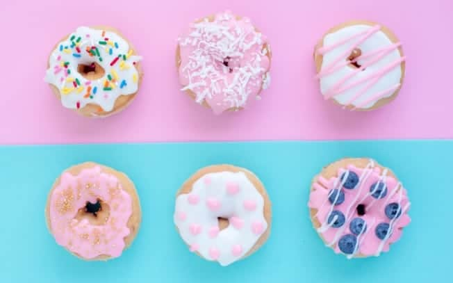 6 donuts on a pink and blue background