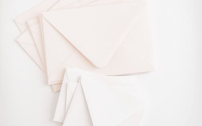 Pink envelopes on a white surface