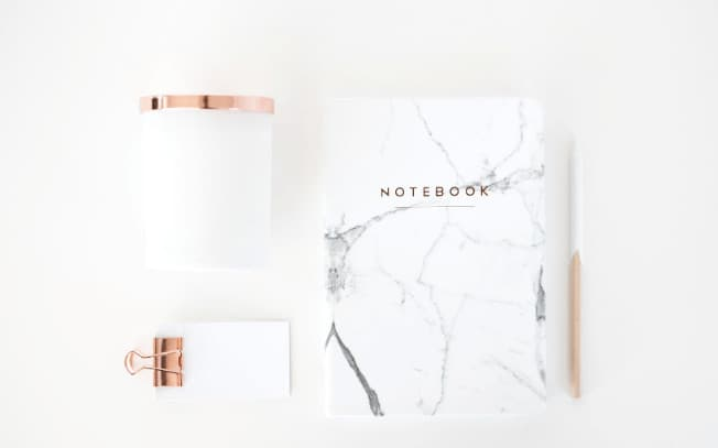 Marble patterned notebook styled alongside notepad