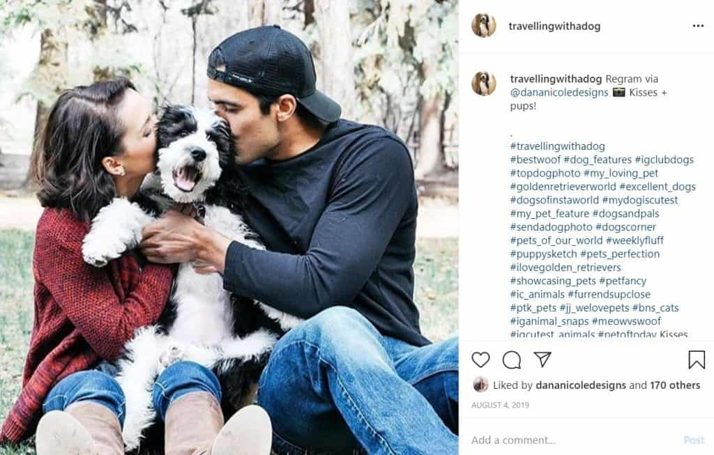 Screenshot of an Instagram photo of a man and a woman giving a kissing to their dog who is in between them
