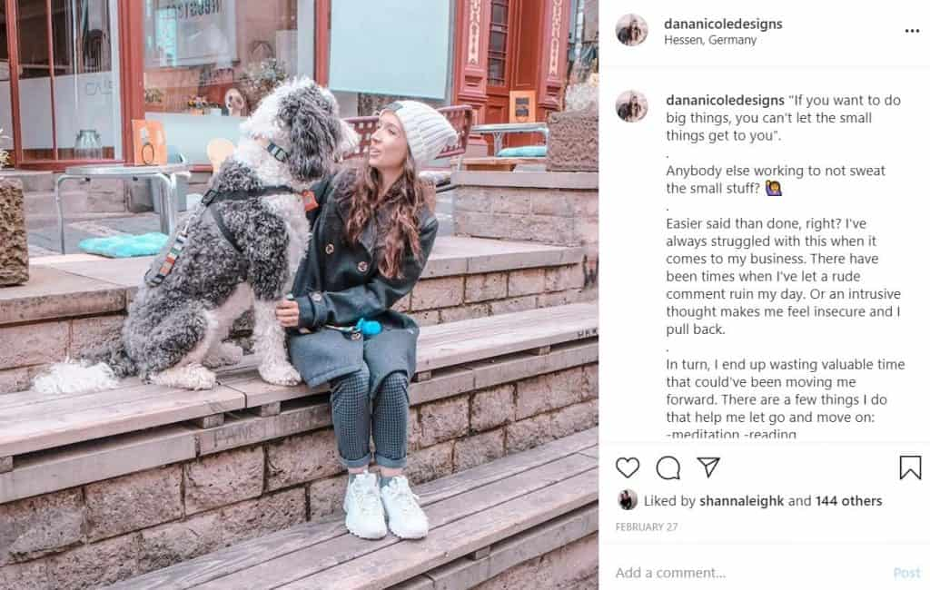 Screenshot of an Instagram photo of a girl looking and smiling at her dog