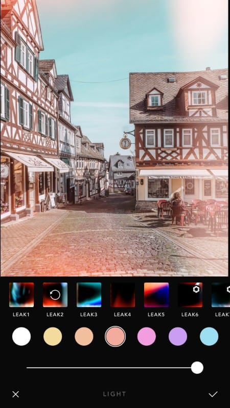 Screenshot of a photo editing app, adding lightening effects into an image
