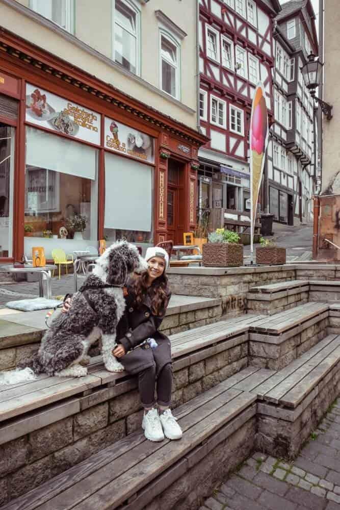 girl and dog sitting together